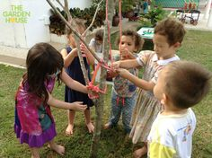 Decorating the Birthday Tree! Great imagination - the children said the tree turned 5 so they decorated & sang to it! (Reggio Inspired & play based learning at The Garden House Preschool in Singapore)