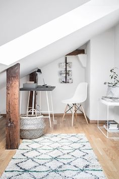 Attic masterfully repurposed into a study in this stunning Swedish apartment