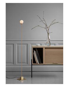 Snowball is a modern take on the classic Bauhaus lamp, revealing how the Futurist and Cubist styles of the Interwar period continue to appear contemporary. Lampe Bauhaus, Vinyl Platten, Interwar Period, Hallway Inspiration, Floor Design, Snowball, Minimalist Design, Floor Lamp, Sideboard