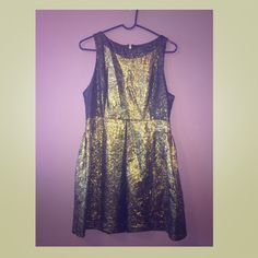 TIBI Metallic Jacquard Dress Crew neck dress, keyhole at bust and silk chiffon overlays at paneled bodice. The gold stitching by the keyhole is missing a bit but dress never worn. Sleeves and should dry clean, lined with zipper in the back. Tibi Dresses