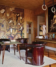 Gianni Agnelli's cork-lined study epitomized his rarefied taste. It featured an ormolu-mounted Louis XVI table with a painting by Alexandre Romain Honnet on the wall above and a sculpture of a torso by Aristide Maillol. Photo: Eric Boman