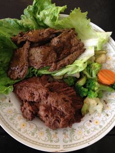 Carne Asade steak wrapped in lettuce with black beans and mixed Veggies. - Low Carb Diet Lunch