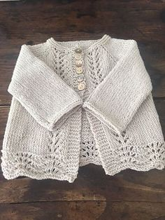 Old Shale Cardigan - Knitting Pattern (Beautiful Skills - Crochet Knitting Quilting)Photo above © Anne B Hanssen This knitting project is available from Ravelry. Full Post: Old Shale Cardigan Baby Knitting Patterns, Baby Sweater Patterns, Cardigan Pattern, Knitting For Kids, Baby Patterns, Free Knitting, Baby Cardigan Knitting Pattern Free, Finger Knitting, Scarf Patterns