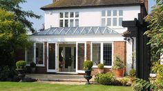 View the timber and brick orangery created for London-based clients; a beautiful addition to their home and a great new living and entertaining space. What Is A Conservatory, Glass Conservatory, Old Window Greenhouse, Bay Window Design, Sunroom Dining, Orangery Extension, Greenhouses For Sale, House Furniture Design, House Design