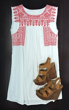 love this embroidered peasant dress! I have it in red and navy!