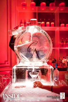 Spectacular ice sculpture with martini/cocktail luge