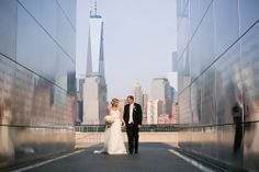 """These kind of shots, by Femina Photo + Design are """"Only in NJ""""! A cityscape backdrop for Stephanie and Matthew at their Liberty House wedding in Jersey City."""