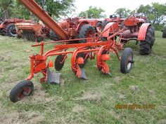 3 bottom Allis Chalmers plow behind WC