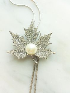 Check out this item in my Etsy shop https://www.etsy.com/listing/465957178/silver-maple-necklace-with-swarovski-and