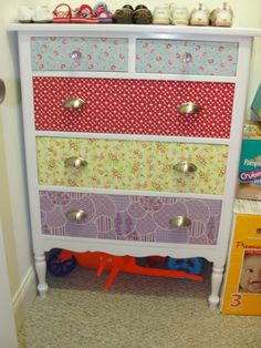 refinished dresser - painted body white and covered the drawers fronts in fabric... cute for a child's room!