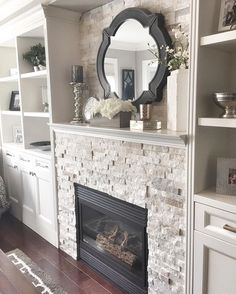 Living room ideas: fireplace, built in shelving with cabinets on either side, color, mantel sunk in
