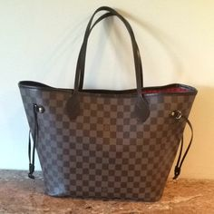 Louis Vuitton Neverfull Mm DAMIER EBENE Tote Bag. Get one of the hottest styles of the season! The Louis Vuitton Neverfull Mm DAMIER EBENE Tote Bag is a top 10 member favorite on Tradesy. Save on yours before they're sold out!
