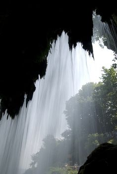 Behind the waterfall, Edessa, Greece (by Andrew Pescod).