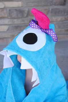 DIY Hooded Monster Towel: Bath Towel in any color, Matching Hand Towel to cut in half, white and black fabric for the eyes, Heat n Bond, other accessories: fabric, towels, felt, fur, ribbon, etc