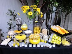 Love the yellow, grey and black colour scheme on this candy buffet