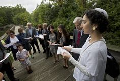 Rabbi Séverine Sokol of Temple Sinai leads a group in song during a Tashlich ceremony at Lake Maury following Rosh Hashanah observances on Thursday in Newport News. (Photo by Kaitlin McKeown / Daily Press) Pics For Dp, Newport News, Rosh Hashanah, Rabbi, Hampton Roads, The Hamptons, Thursday, Temple, Songs