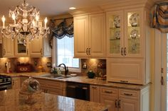 Love the appliance garage and glass fronts on cabinets.