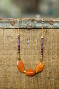Carnelian and Purple Seed Bead Necklace by RootsAndWingsJewelry  Really lovely