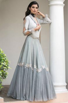 The Stylish And Elegant Fusion Lehenga Choli In Grey Colour Looks Stunning And Gorgeous With Trendy And Fashionable Raw Silk Chiffon Fabric Looks Extremely Attractive And Can Add Charm To Any Occasion. Indian Fashion Dresses, Indian Bridal Outfits, Indian Gowns Dresses, Dress Indian Style, Indian Designer Outfits, Indian Wedding Gowns, Stylish Dress Designs, Designs For Dresses, Stylish Dresses