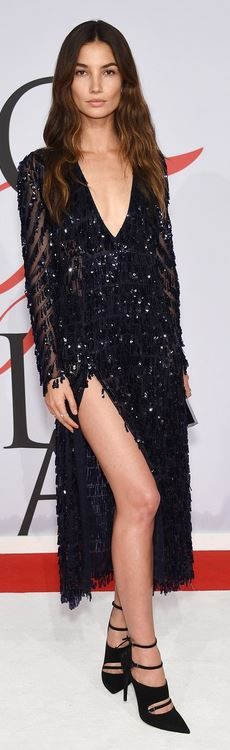 Who made Lily Alridge's black buckle pumps, clutch handbag, and blue fringe beaded gown?