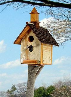 119C  Rustic salvage wood church style birdhouse on post with steeple, front stairs and antique skeleton key perch recycledbirdhouse.com