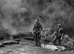 Ruediger Richter watches a helicopter prepare to land to pick up the body of a soldier killed by mortar fire in South Vietnam on Aug. 14, 1966. The image came to be known as 'The Agony of War' and made Richter an iconic figure of the war. - U.S. Army photo by Pfc. Paul Epley via AP ~ Vietnam War