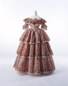 Evening Dress c. 1855-France  Material:   Crème silk and wool mixed gauze with floral print; triple-flounced skirt.