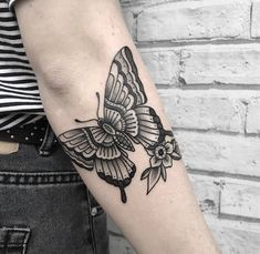Traditional black butterfly tattoo