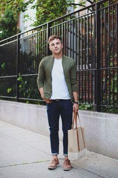 Men's Olive Quilted Bomber Jacket, White Crew-neck T-shirt, Navy Jeans, Tan Suede Brogues