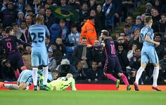 Lionel Messi of FC Barcelona scores the first goal during the UEFA Champions League match between Manchester City FC and FC Barcelona at Etihad...