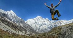 Trekking the Himalayas,  Nepal Notice huge smile on my face as I jump off a big Rock to get this shot while using a timed camera on  tripod.  Landed on my ankle wrong.  The hike got a tiny bit harder after that.