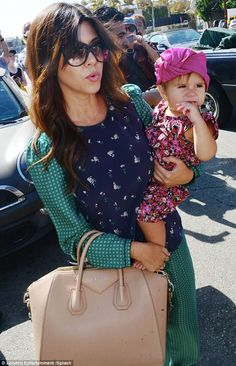 What a little cutie! Late Kourtney was seen carrying her adorable daughter Penelope who sported a pink turban