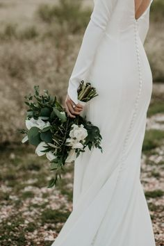 Bridal bouquet with white flowers and tons of fresh greenery | Image by Summer Leigha Photography #modernwedding #minimalistwedding #rusticwedding #mountainwedding #coloradowedding #wedding #weddinginspiration #weddingphotography #weddingflowers #weddingflorals #bouquet #bridalbouquet #weddingbouquet
