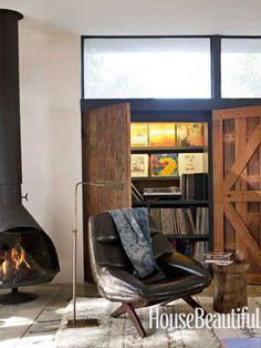 Storage wall and DJ station! Design: Pamela Shamshiri/Commune Design. housebeautiful.com
