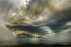 Amateur photograph Oleg Ivanov captures a massive storm cloud that covered a beach in Baltiysk near the northwest Russian coast this summer.