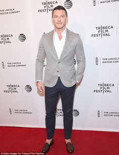 Showing his style: Luke, 37, donneda grey blazer over a white dress shirt with the top fe...