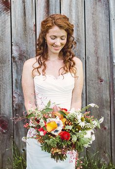 Brides.com: 40 Bright and Beautiful Wedding Bouquets!. Bouquet of coral bells, anemones, ranunculuses, echinacea, and viburnum, $350, Erin Ostreicher Designs