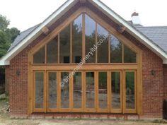 Impressive six door bi-folding sliding doors made from oak hardwood with clear osmo oil by www.brownsjoineryltd.co.uk