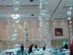 Use clear balloons for centerpieces and it will create an AWESOME under the sea vibe for your quinceanera :)