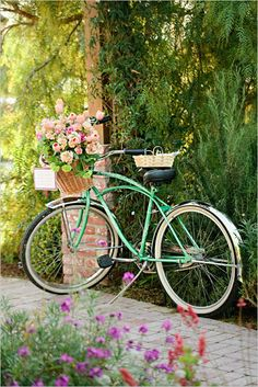 Bike with flowers in basket - near entrance of ceremony