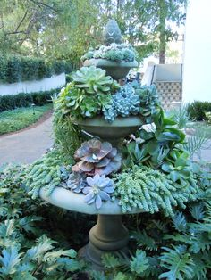 Though I don't get enough suns to do it with succulents, like this one, I love the idea of a botanical tiering with several stacked bird baths. I'd likely leave one for water and the lovely birdies.