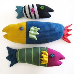 A school of three Under-the-Sea Beasts. Ready to ship!These three fishies are part of The New Recycles family, creatures born from once-loved sweaters and scarves and old buttons.Little Black Stripey is 10 inches long (25cm).Green Stripes Pinky is 14 inches long (36cm).Big Blue Fuzzy comes in at a whopping 18 inches (46cm) long. This school of fish is being sold with all 3 fish included. Can't break the school apart, right