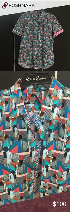 Robert Graham Classic Bahamas style shirt Robert Graham X COLLECTION in the classic Bahamas Style multi color Tailored Fit shirt.  The short sleeve turns up into a charming color.  Multi color interior button down facing. Robert Graham Shirts Casual Button Down Shirts