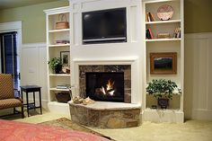 Lane Myers Construction Custom Home Builder Field of Dreams Master Bedroom Fireplace White Trim Stone Fireplace