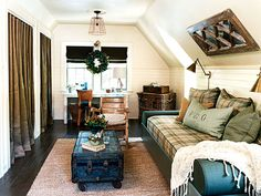 Attic space with turquoise, tan and brown plaid day bed cushion - muted turquoise door & throw pillows - from Cottage Living - Photo: Robbie Caponetto