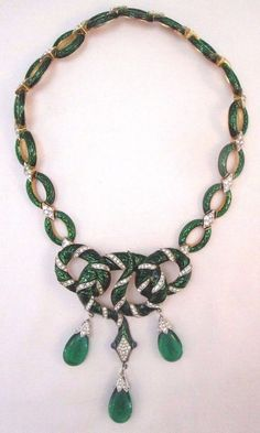 """Backside of necklace is marked, """"Trifari."""". Green marbled glass stones dangle from the necklace. The clasp opens and closes securely. All created diamond stones are intact. 