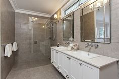 Ensuite bath.  Love the seamless look of the shower.