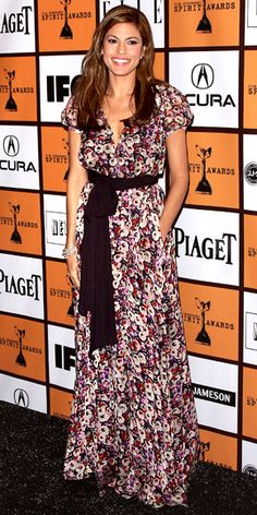 Eva Mendes wearing a flowing floral Peter Som maxi-dress with stacked Vahan bangles.