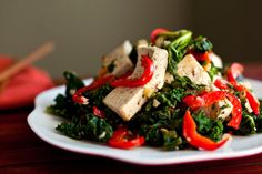 Spicy stir-fried tofu with kale and red pepper. Photo: Andrew Scrivani for The New York Times