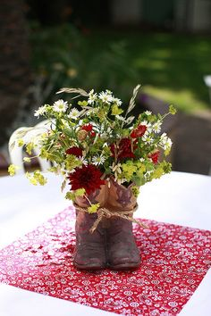 If you want to find very comfortable wedding shoes you have two top choices, one is to wear cowgirl wedding boots (as many of our readers choose). Cowboy Boot Centerpieces, Western Wedding Centerpieces, Wedding Decorations, Cowboy Party Centerpiece, Centerpiece Ideas, Flower Centerpieces, Cowgirl Wedding, Rustic Wedding, Wedding Boots